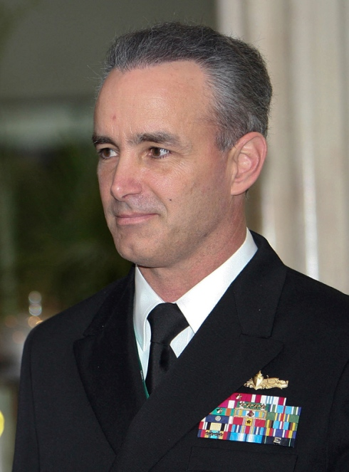 Admiral Gayouette provided surveillance for General Hamm's attempted rescue of Ambassador. He was discovered and arrested by his executive officer a CIA plant.