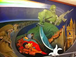 Var detta kommande moment förutsagt på väggmålning på Denver International Airport nära bagage pick-up?