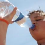 Teen-Boy-Drink-Water-Plastic-Bottle