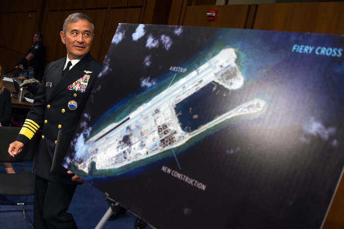 The Navy briefs the media, the public and its Asian allies on America's intent to challenge the territorial waters of the artificially created Chinese Islands which threatens the freedom of the seas in the region.
