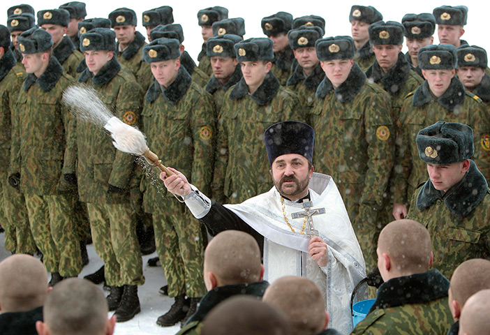 The Russian military embraces their Christian faith.