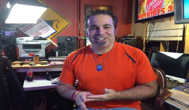 Talk show host, Pete Santilli, arrested without cause at gun point for impeding traffic.