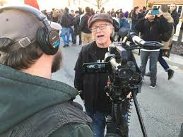 Bill Ayers posing for the establishment media while inciting violence in Chicago at a Trump political rally.