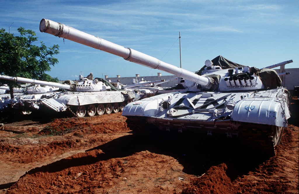 T-72 main battle tanks with UN markings.
